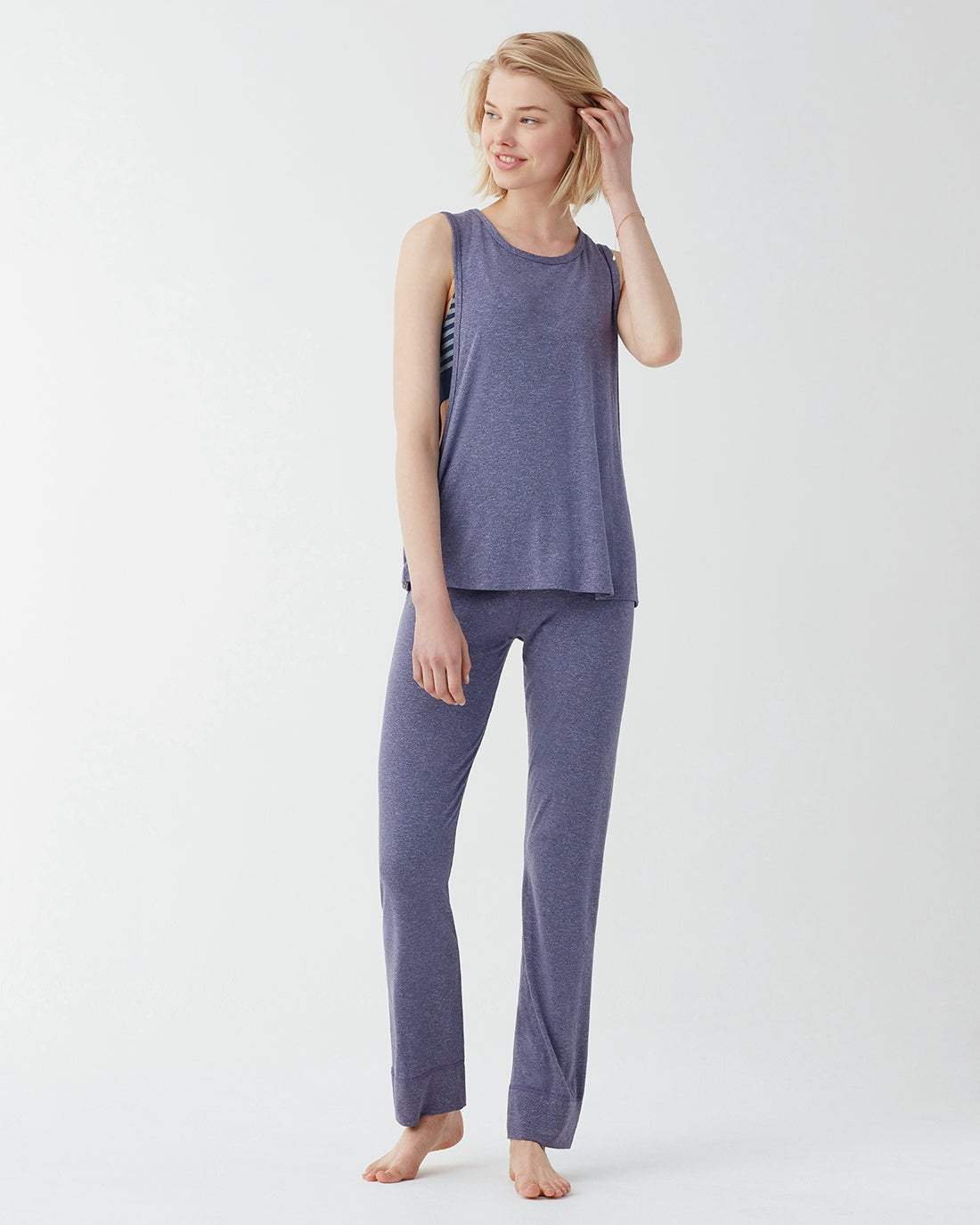 Long yoga pants cut front soft and flexible purple heathered marled knit. Designed with rollover waistband which adds both comfort and style. Wear two ways: as an open leg pant or snapped up jogger Yoga pants Roll over waistband Relaxed fit Moisture wicking fabric